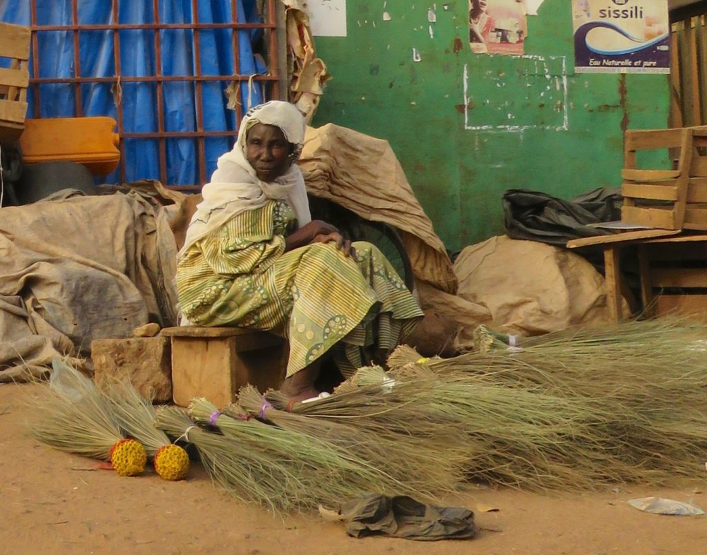 Woman on market in Leo